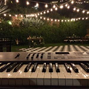 Wedding Reception Design Keyboard and Checker Dance Floor